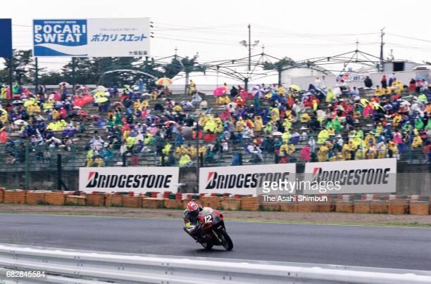Rider competes in the Suzuka 8Hours Endurance Race at Suzuka Circuit on July 27, 1997 in Suzuka, Mie, Japan.