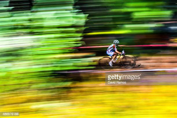 A rider competes in the Women's Elite CrossCountry Olympic race during day 5 of the UCI Mountain Bike Trials World Championships on September 5 2015...