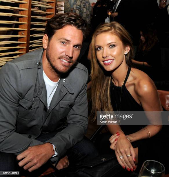 BMX rider Corey Bohan and reality tv actress Audrina Patridge pose at the after party for the premiere of Open Road Films' End of Watch at WP24 on...