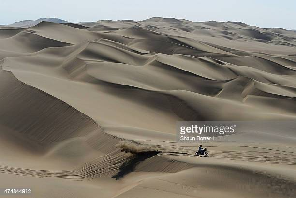 A rider crosses the dunes during the stage from Pisco to Nazca on day three of the 2013 Dakar Rally on January 7 2013 in Pisco Peru