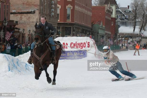 Rider Dana Stiles races down Harrison Avenue towing skier Mike Fries during the 68th annual Leadville Ski Joring weekend competition on March 5 2017...