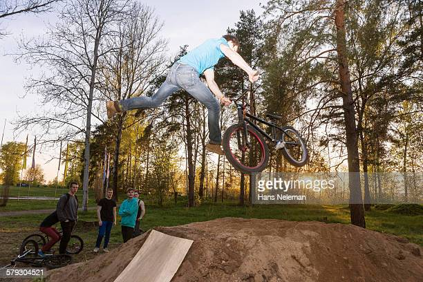 A BMX rider doing a stunt in mid-air