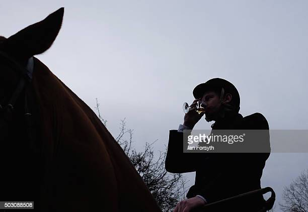 Rider drinks a Whisky as the tradition drinks are passed around as horses, riders and hounds from the Cleveland Hunt prepare to ride out on the...