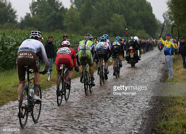 Rider enter the final section of cobbles during stage five of the 2014 Le Tour de France on July 9 2014 in Wallers Belgium