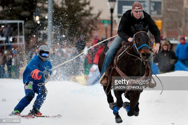 Rider Eric Mikkelsen and skier Shawn Gerber race down Harrison Avenue during the 70th annual Leadville Ski Joring weekend competition on March 4 2018...