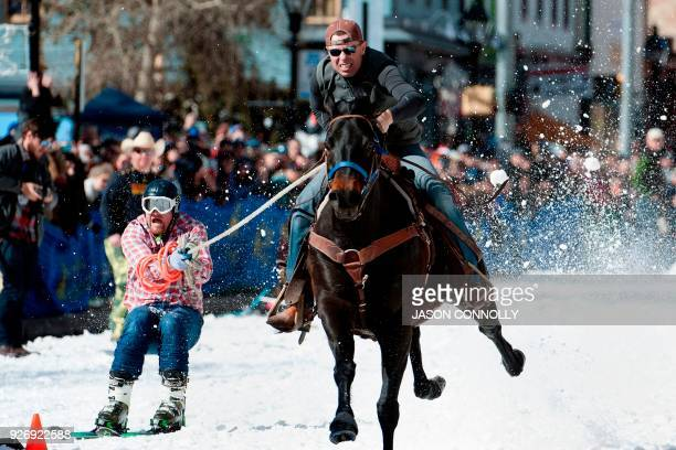 TOPSHOT Rider Eric Mikkelson and skier Jason Dahl race to the finish line during the 70th annual Leadville Ski Joring weekend competition on March 3...