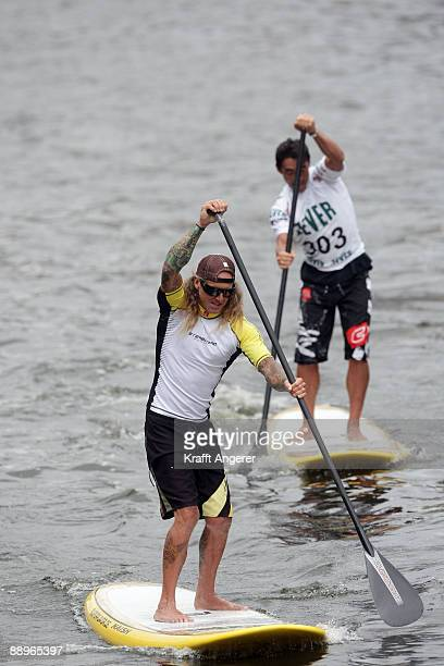 Rider Ernest Johnson and Taka Kamaguchi on their standup paddleboards during day one of the Jever SUP World Cup 2009 on July 10 2009 in Hamburg...