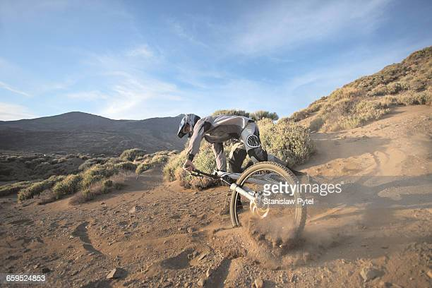 rider falling down on mountain bike - pico de teide stock pictures, royalty-free photos & images