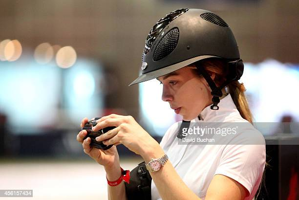 Rider Hannah Selleck participates in the Masters Grand Slam Trophy class as part of the Longines Los Angeles Masters at Los Angeles Convention Center...