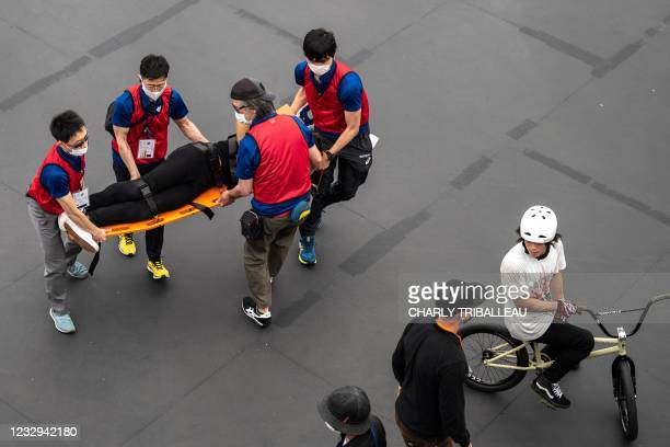 Rider is assisted after getting injured in the BMX freestyle track venue during a test event for the Tokyo 2020 Olympic Games at Ariake Urban Sports...