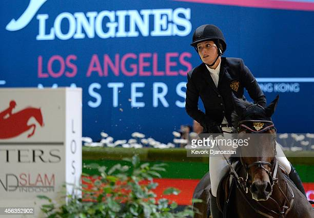 Rider Jessica Springsteen rides Vindicat W during the Longines Grand Prix class as part of the Longines Los Angeles Masters at Los Angeles Convention...
