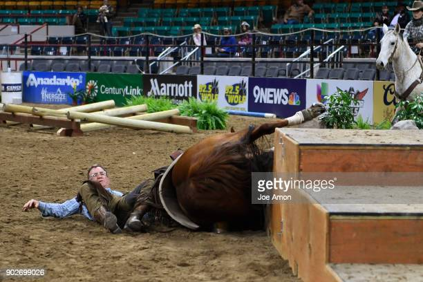 Rider Jim Goff and his horse took a tumble doing a 360 a level 3 maneuver that is not used in the competition on top of the Texas Two Step during...