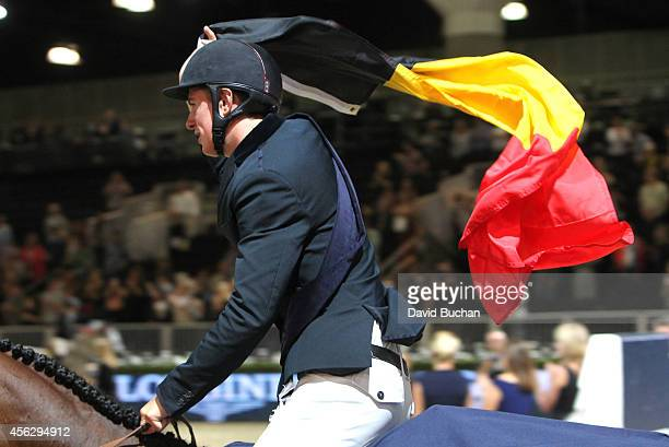 Rider Jos Verlooy of Belgium celebrates his first place finish in the Longines Grand Prix class as part of the Longines Los Angeles Masters at Los...