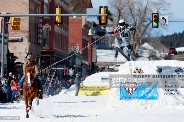 TOPSHOT Rider Josh Abbott races down Harrison Avenue while skier Mike Fries airs out off the final jump of the Leadville ski joring course during the...