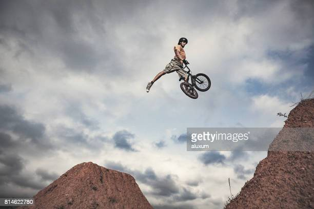 bmx rider jumping high real jump - high jump stock pictures, royalty-free photos & images
