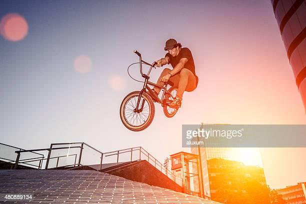 BMX rider jumping in urban environment