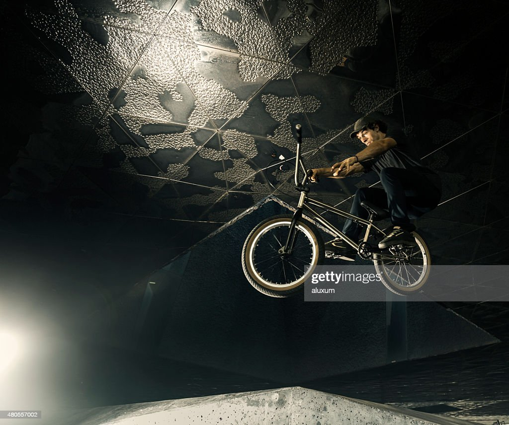 BMX rider jumping : Stock Photo