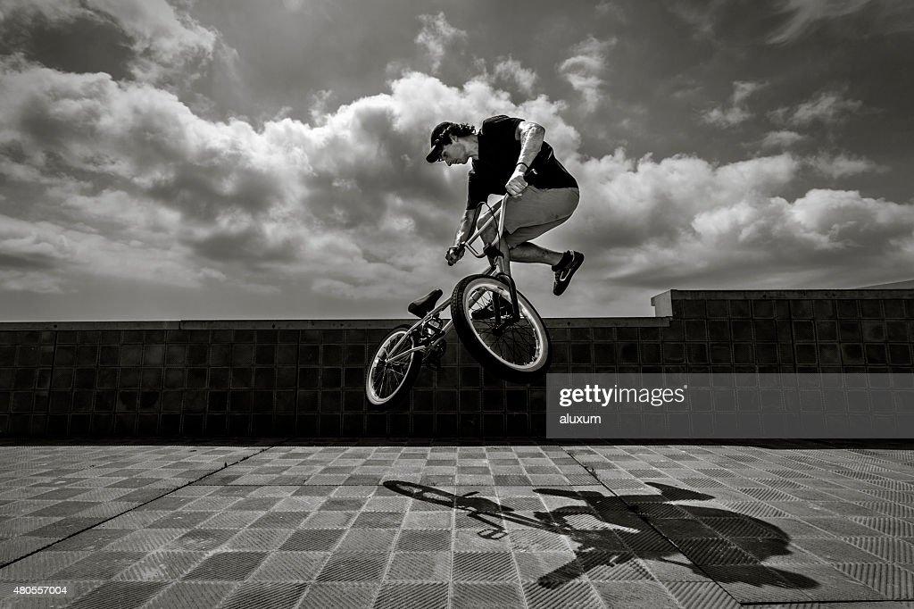 BMX rider jumping : Stock Photo