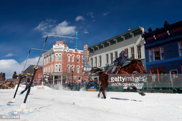 Rider Krista Halsmes and skier Reuel MacDonald race down Harrison Avenue during the 70th annual Leadville Ski Joring weekend competition on March 4...