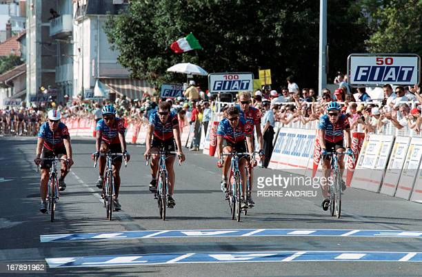 US rider Lance Armstrong and his Motorola teammates get ready to cross the finish line together at the end of the 16th stage of the Tour de France...