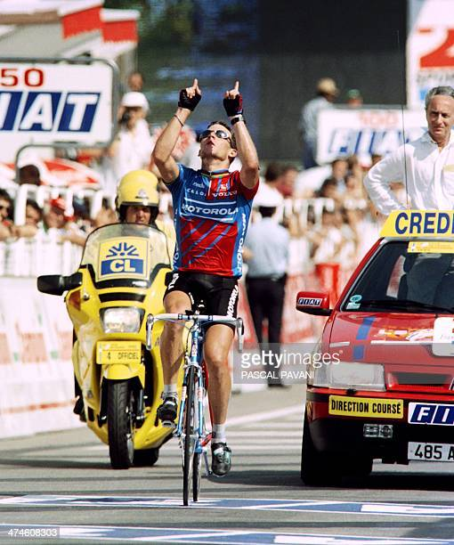 US rider Lance Armstrong points his fingers to the sky as he wins the 18th stage of the Tour de France between MontponMénestérol and Limoges on July...