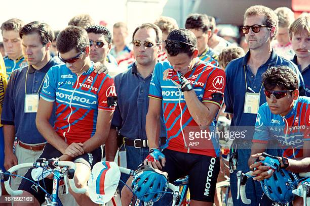 US rider Lance Armstrong tries to hold off tears as he and his Motorola teammates US Frankie Andreu and Colombian Alvaro Mejia stand still while...