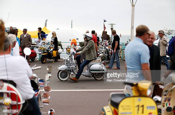 A rider makes his way down the pavement during the Brighton Mod Weekender where mods and their scooters gather on the annual bank holiday weekend...