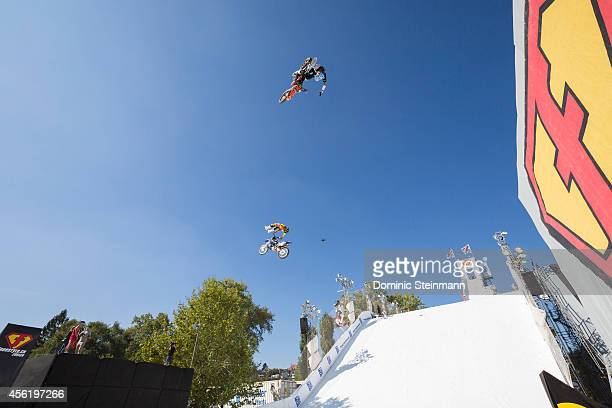 FMX rider Mat Rebeaud of Switzerland above Clinton Moore of Australia during the Style Session run at freestylech Zurich on September 27 2014 in...