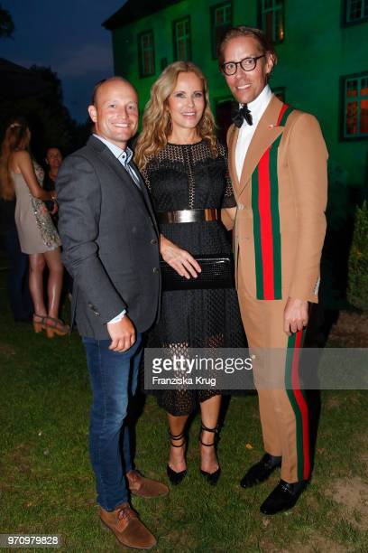 Rider Michael Jung Katja Burkard and Jens Hilbert attend the Balve Optimum 2018 Gala on June 8 2018 in Balve Germany