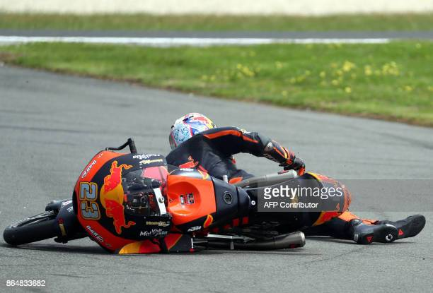 KTM rider Niccolo Antonelli of Italy crashes during the Moto3class Grand Prix of the Australian MotoGP Grand Prix at Phillip Island on October 22...
