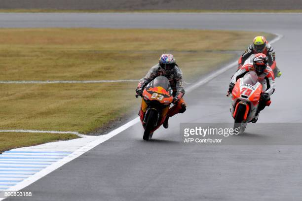 KTM rider Niccolo Antonelli of Italy leads Mahindra rider Albert Arenas of Spain during the Moto3class second practice session of the MotoGP Japanese...