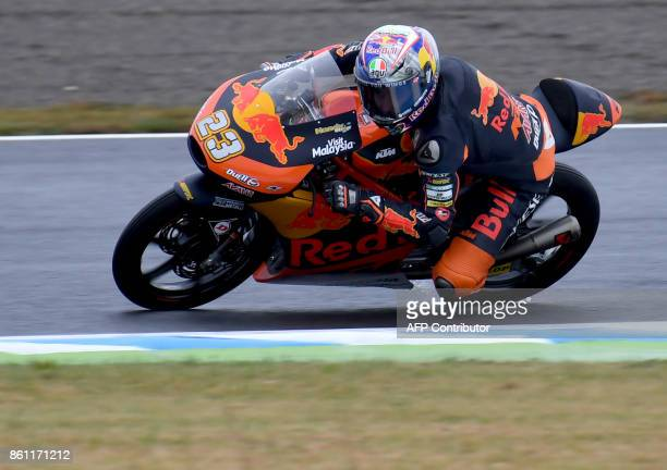 KTM rider Niccolo Antonelli of Italy powers his machine during the Moto3class third practice round of the MotoGP Japanese Grand Prix at Twin Ring...