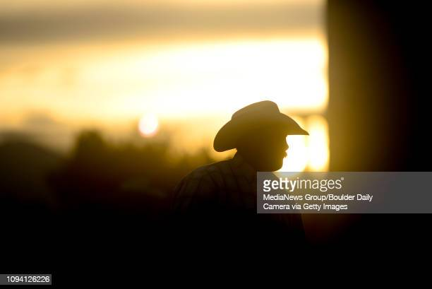 Rider on horseback is seen in the dust as the sun sets, Sunday, Aug. 4 at the Boulder County Fair in Longmont. The CPRA rodeo featured nine events...