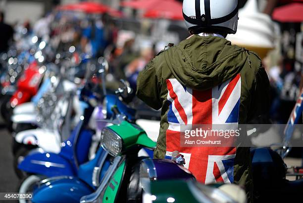 A rider parks his scooter during the Brighton Mod weekender on August 24 2014 in Brighton England This August Bank holiday will see many Mods and...
