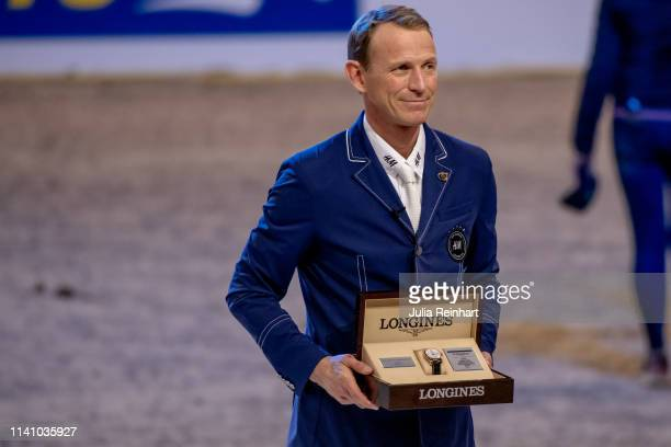 Rider Peder Fredricson from Sweden show off his prize during the price giving ceremony for the 2019 Longines FEI Jumping World Cup Final during the...