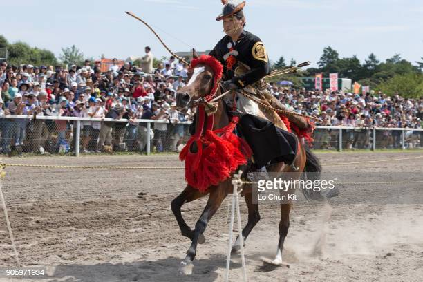 Rider performing the 'Yabusame' horseback archery at Baji Koen JRA's Equestrian Park on September 23 2015 in Setagaya Tokyo Japan In the summer of...