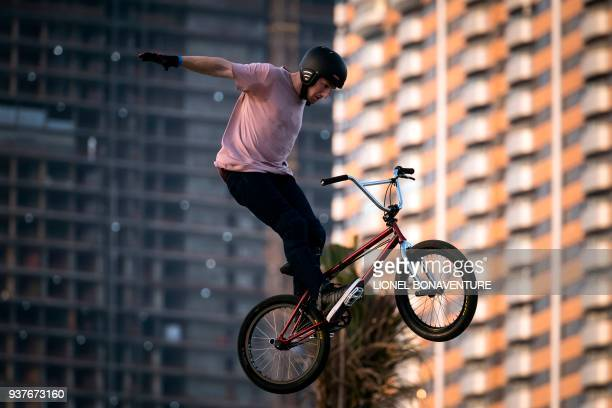A rider performs during the BMX freestyle parc pro final on March 24 2018 in Jeddah during a two days event for the launch of the 2018 FISE World...