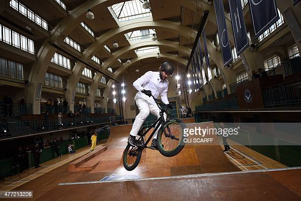 Rider performs in Seymour Leisure Centre at a presentation for designer British designer Jimmy Choo on the fourth day of the Spring/Summer 2016...