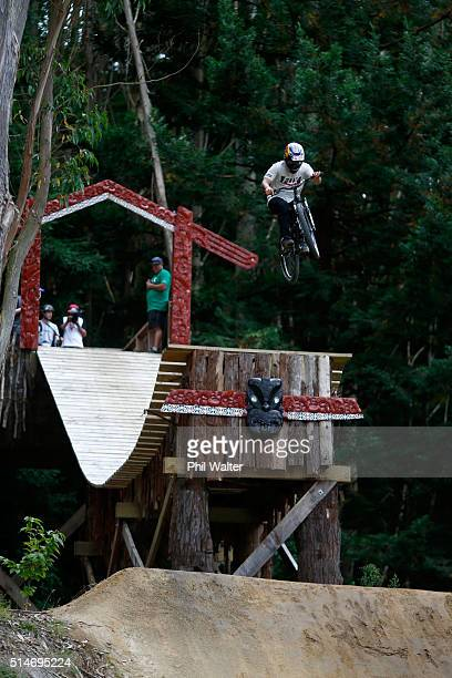 A rider practices the Slopestyle course above Lake Rotorua on day three of the Crankworx mountain bike festival on March 11 2016 in Rotorua New...
