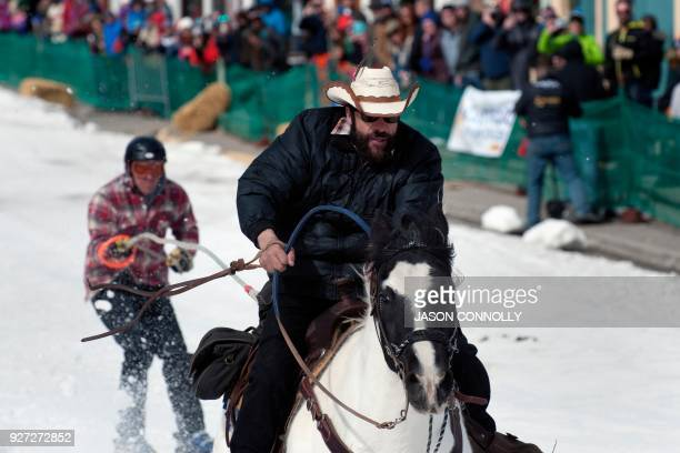Rider Rafael Bujando of Eagle Colorado and skier Chris Pitcher race down Harrison Avenue during the 70th annual Leadville Ski Joring weekend...
