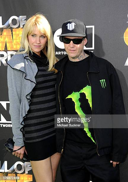 BMX rider Rick Thorne and wife Madona Thorne arrive at the Cartoon Network Hall of Game Awards held at The Barker Hanger on February 21 2011 in Santa...