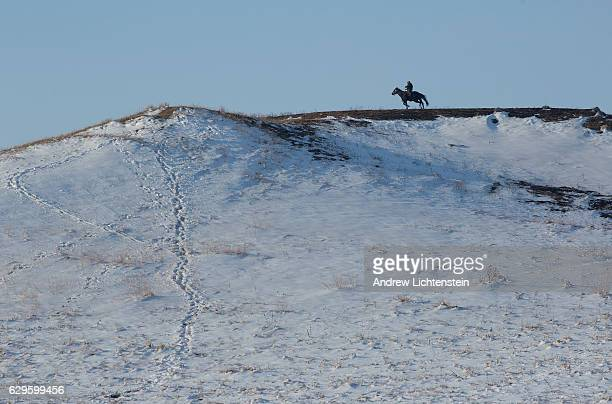 A rider serving as a sentry for the Oceti Sakowin campJust outside of the Lakota Sioux reservation of Standing Rock North Dakota watches for law...