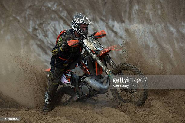A rider struggles with his bike as he competes during the main solo race of the 2013 RHL Weston annual beach race in WestonSuperMare on October 13...