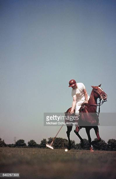 A rider swings his polo mallet during a match at the Pony Club in Unionville Pennsylvania