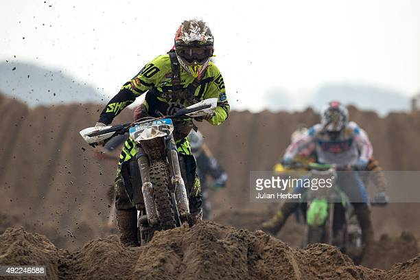 A rider tackles a dune during The Adult Solo Class during the RHL Weston Beach Race held on the beach at WestonSuperMare on October 11 2015 in...