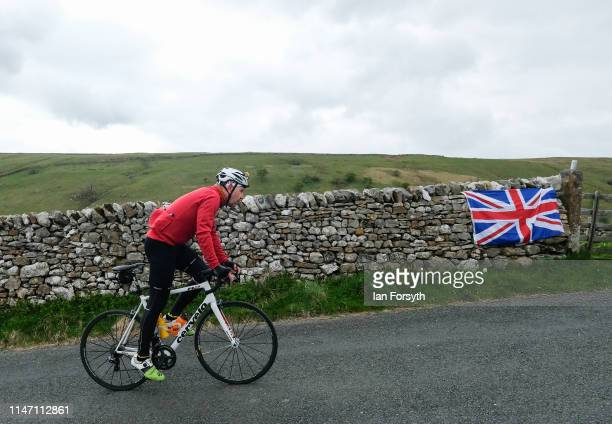 A rider tackles the Cote de Park Rash ascent near the village of Kettlewell in the Yorkshire Dales ahead of the arrival of the peloton during the...