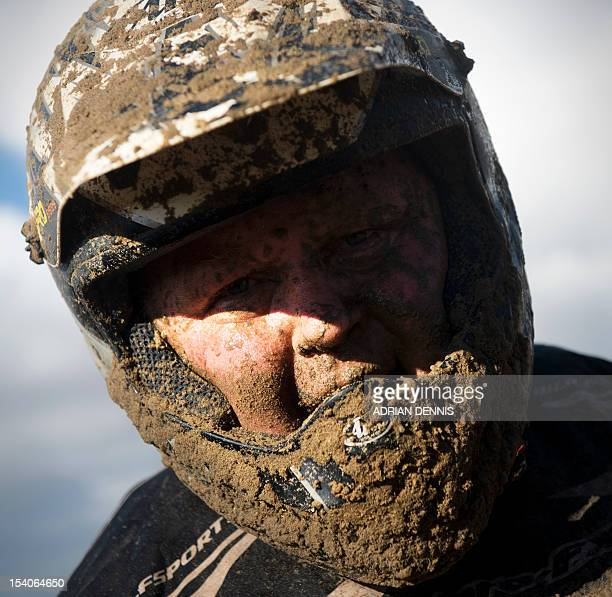 A rider takes a moment to rest after his bike broke down during the main quad and sidecar race during the 2012 RHL Weston beach race in...