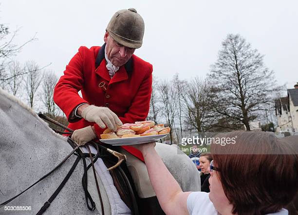 Rider takes a sandwhich as horses, riders and hounds from the Cleveland Hunt prepare to ride out on the traditional New Year's Day hunt on January 1,...