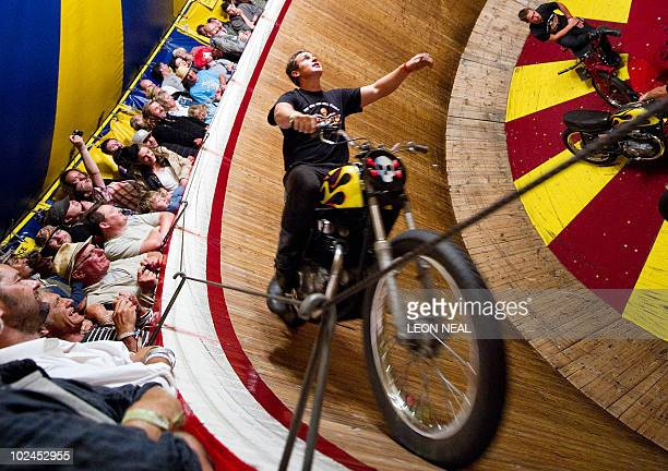A rider takes the 'Wall of Death' in the Block 9 area of the Glastonbury festival near Pilton Somerset on June 26 2010 Celebrating its 40th...