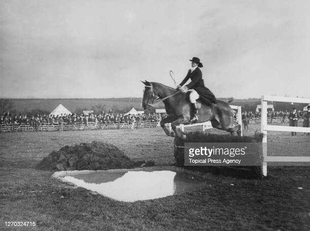 Rider takes the water jump in the Subscribers' Competition at the North Kent Agricultural Show in Swanley, 7th November 1912.